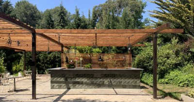 Outdoor pergola with wooden slats
